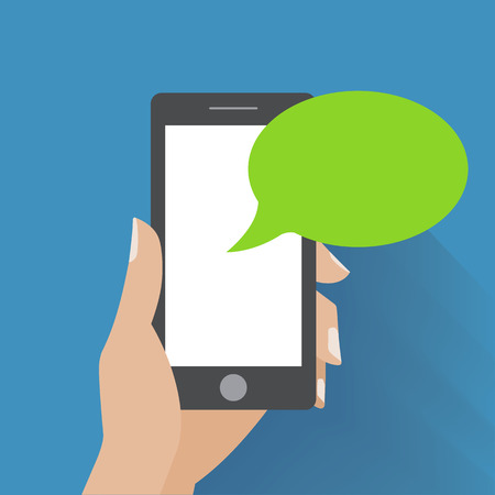 Hand holing smartphone with blank speech bubble for text. Using smart phone similar to iphon for text messaging.