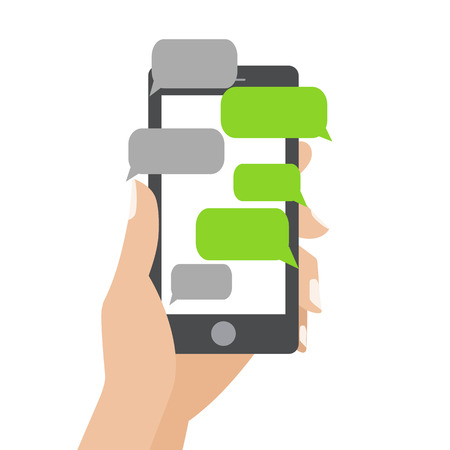 using phone: Hand holing black smartphone similar to iphon with blank speech bubbles for text. Text messaging flat design concept.