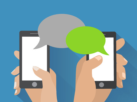 text: Hands holing smartphone with blank speech bubble for text. Using smart phone similar to iphon for text messaging.