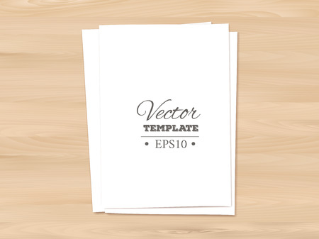 pile of papers: Template of a blank paper sheet on wooden background