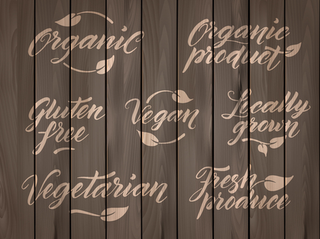 produce product: Retro styled healthy food letterings. Label, logo template stylized with stamp effect on a wooden background. Organic, organic product, gluten free, vegan, locally grown, vegetarian, fresh produce. Eps 10 vector. Wooden effect can be easily removed from l
