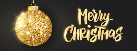 Hanging Christmas golden ball on black background. Sparkling metal glitter bauble. Merry Christmas hand drawn text
