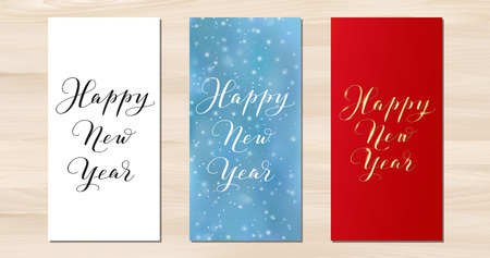 Happy New Year vertical cards. Hand drawn calligraphy isolated on white, gold on red. Blue background with falling snow