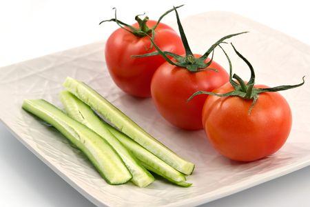 Vegetarian plate from tomatoes, cucumbers, pepper-vitamin diet