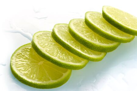 Lime cut on slices and laid out for preparation of cocktails and soft drinks