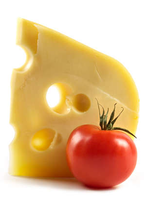 Big piece of fragrant elite cheese and tomatoes-pleasures taste and aroma for a gourmet photo