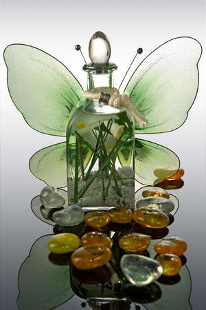 Bottle with aromatic oil-accessory of weakening and improving procedures of aromatherapy