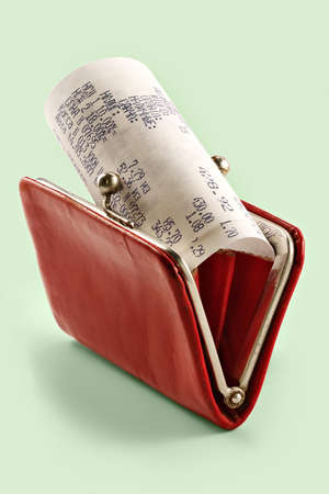 total loss: Cash receipt on background of a purse-how to spend money without damage to the family budget Stock Photo
