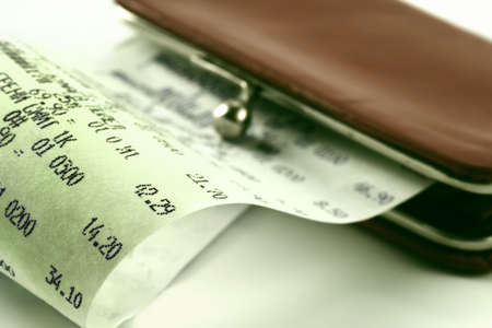 Cash receipt on background of a purse-how to spend money without damage to the family budget Archivio Fotografico
