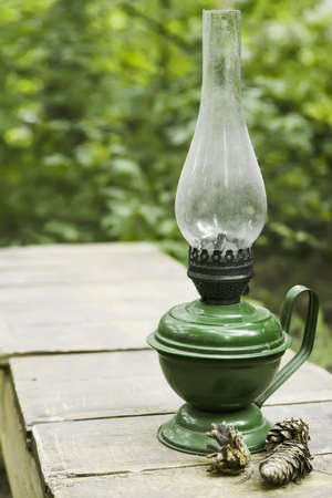 Country life item-ancient oil lamp under layer of dust Stock Photo