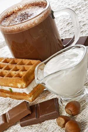 Cup of hot chocolate and wafer-nourishing high-calorie breakfast photo