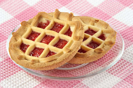 Tartlet with cherry jam-sweet entertainment to tea Stock Photo