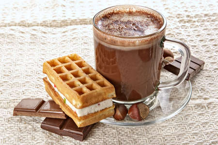Cup of hot chocolate and wafer-nourishing high-calorie breakfast Stock Photo