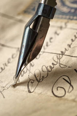Ancient letter written by beautiful handwriting and an ink feather photo