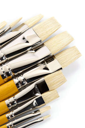 Set of clean paintbrushes on a white background photo