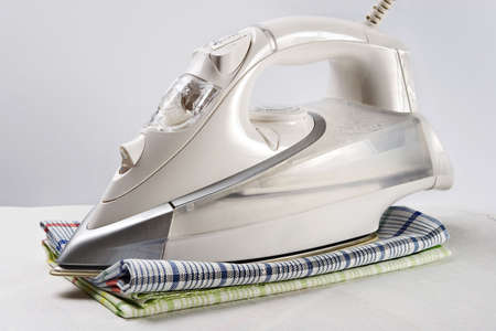 White iron and towels-symbols of neatness and cleanliness photo