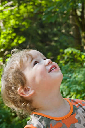 admired: admired and surprised boy on walk in a scaffold in a sunny day Stock Photo