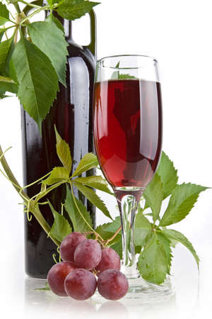 Romantic wine still-life with grapevine,  bottle and glass photo