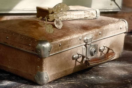 belongings: Beloved  grunge trash-suitcase and shabby book Stock Photo