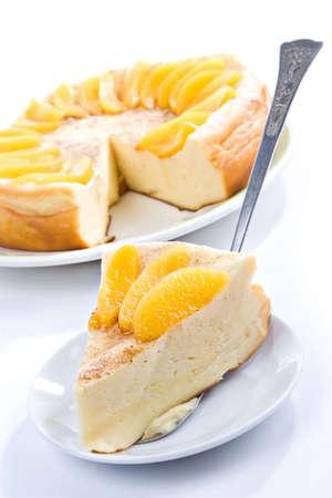 big celebratory vanilla pudding pie with peach segments