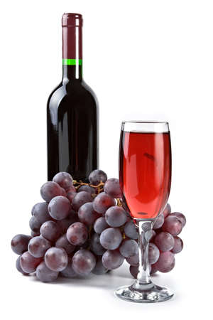 Cluster of red grapes, glass and bottle isolated on a white background