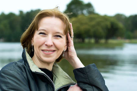 Portrait of attractive mature woman dreaming about something pleasant Archivio Fotografico