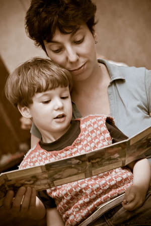 Mother and  boy together read the book of fairy tales before a dream Archivio Fotografico
