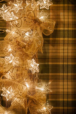 Garland christmas decoration-sparkling bright bulbs and gold bows Archivio Fotografico
