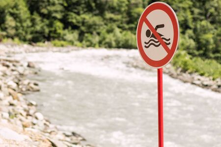 Dont swim sign. Mountainng river. Concept of swimming is prohibited. Copy space Stock Photo