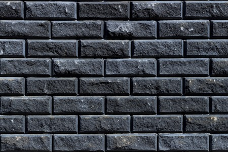 Grey wall as background, texture of a grey brick wall