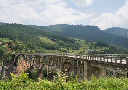 Concrete arch Djurdjevica (ĐurÄ'evića) Tara bridge over the Tara River in Montenegro 写真素材