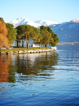 Beautiful view on trees reflecting in a lake. Locarno, Switzerland