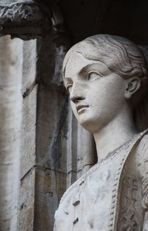 Marble statue of a young woman. Building on Grand Plaza in Brussels, Belgium