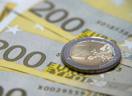Close up of two hundred euro notes and two euro coin