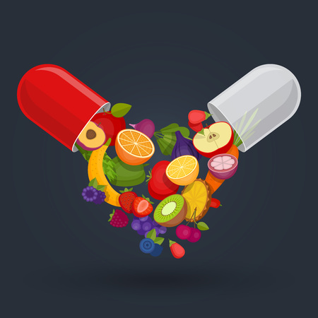 Medical capsule with fruit and vegetables. Vitamins and supplements. Different fruit in capsule.