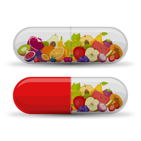 Medical capsule with fruit. Vitamins and supplements. Different fruit in capsule.