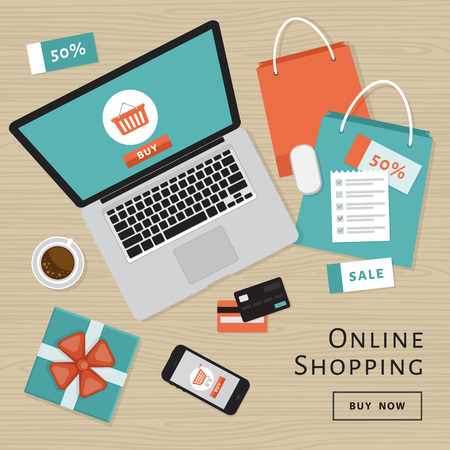 Online shopping concept. Online store objects and banner. Table with laptop, shopping bags, credit cards, gifts and coupons.
