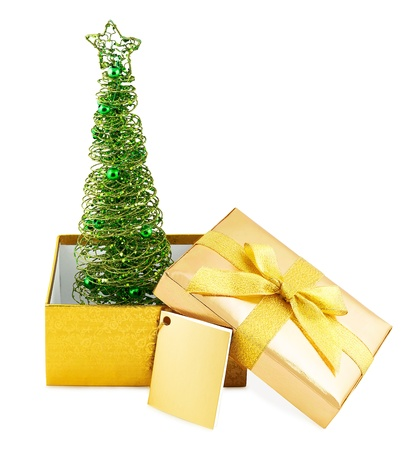 Christmas tree in golden box with bow isolated on white background Stock Photo