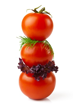 Macro view of red tomatoes with greens isolated on white background Stock Photo - 18010971