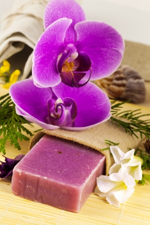 Macro view of handmade soap with orchid and flowers on the mat