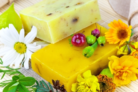 Macro view of natural soap and flowers on the mat Stock Photo