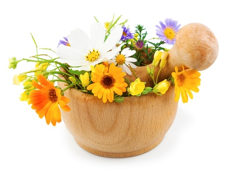 Fresh flowers in wooden mortar isolated on white background