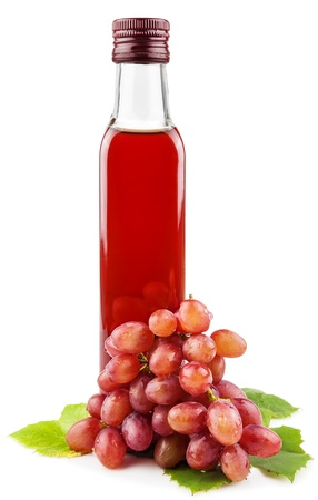 Glass bottle of wine vinegar with a bunch of grapes isolated on white background Reklamní fotografie - 18010961