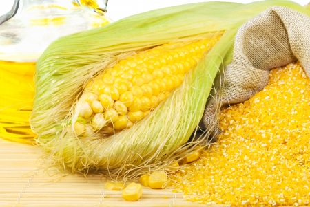 Composition from corn, maize flour and corn oil on the mat isolated on white background Stock Photo