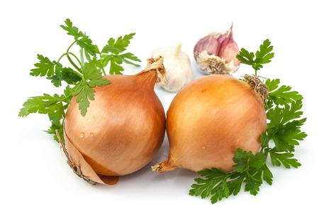 Macro view of onion, garlic and parsley isolated on white background