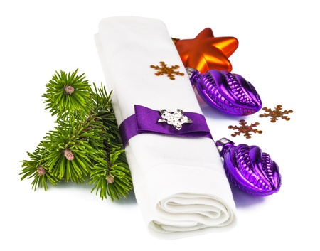 White napkin with Christmas decoration and twig Christmas tree isolated on white background Stock Photo