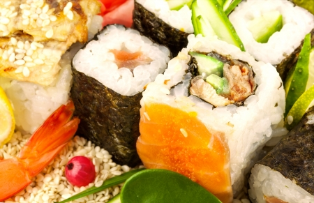 Composition from sushi with green leaf on sesame seeds Stock Photo
