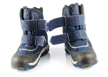 Blue winter boots with fastener isolated on white background Stock Photo