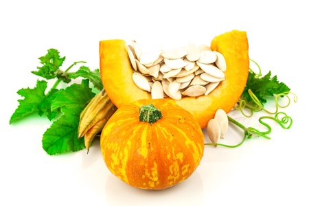 cut flowers: Pumpkin with pumpkin seeds isolated on white background Stock Photo