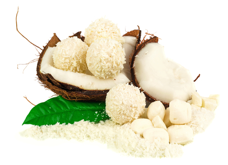 Coconut with coconut candy and green leaf isolated on white Stock Photo